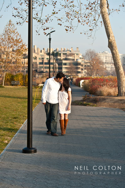 Candid portrait of a couple walking along the Georgetown waterfront in Washington DC.
