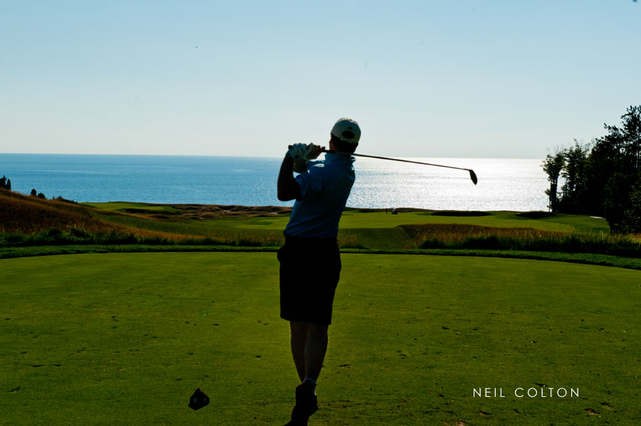 Portrait of a golfer as he tees of at Arcadia Bluffs in Arcadia, Michigan.